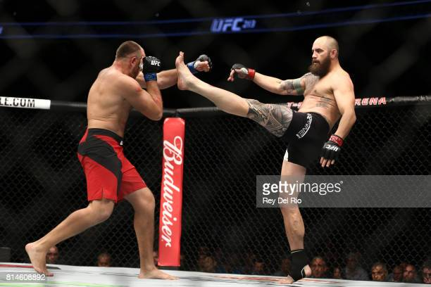 Travis Browne kicks Aleksei Oleinik in their heavyweight bout during the UFC 213 event at TMobile Arena on July 9 2017 in Las Vegas Nevada