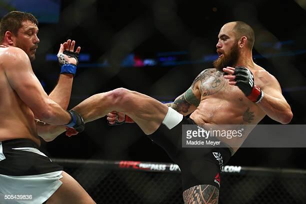 Travis Browne kicks Matt Mitrione in their heavyweight bout during UFC Fight Night 81 at TD Banknorth Garden on January 17 2016 in Boston...