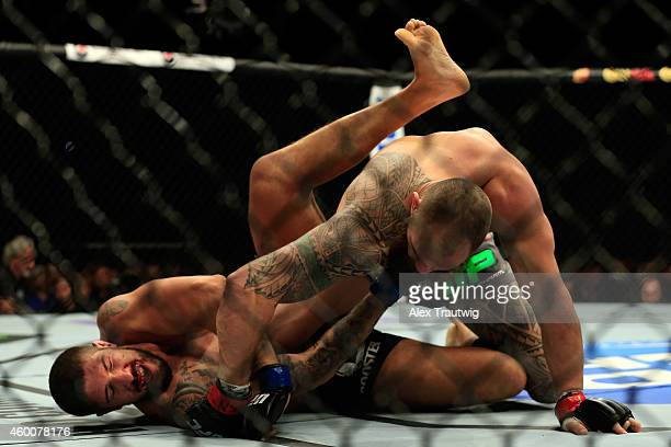 Travis Browne punches Brendan Schaub in their fight during the UFC 181 event at the Mandalay Bay Events Center on December 6 2014 in Las Vegas Nevada