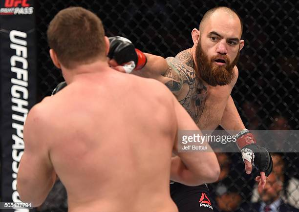 Travis Browne punches Matt Mitrione in their heavyweight bout during the UFC Fight Night event inside TD Garden on January 17 2016 in Boston...
