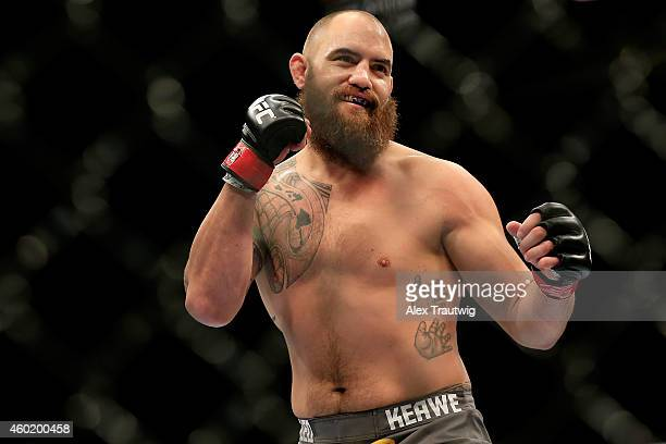Travis Browne reacts against Brendan Schaub in their fight during the UFC 181 event at the Mandalay Bay Events Center on December 6 2014 in Las Vegas...