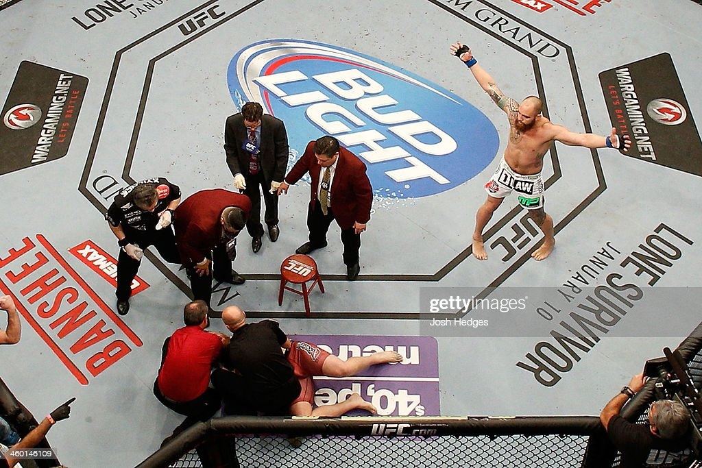 Travis Browne (R) reacts to his victory over Josh Barnett after their heavyweight bout during the UFC 168 event at the MGM Grand Garden Arena on December 28, 2013 in Las Vegas, Nevada.