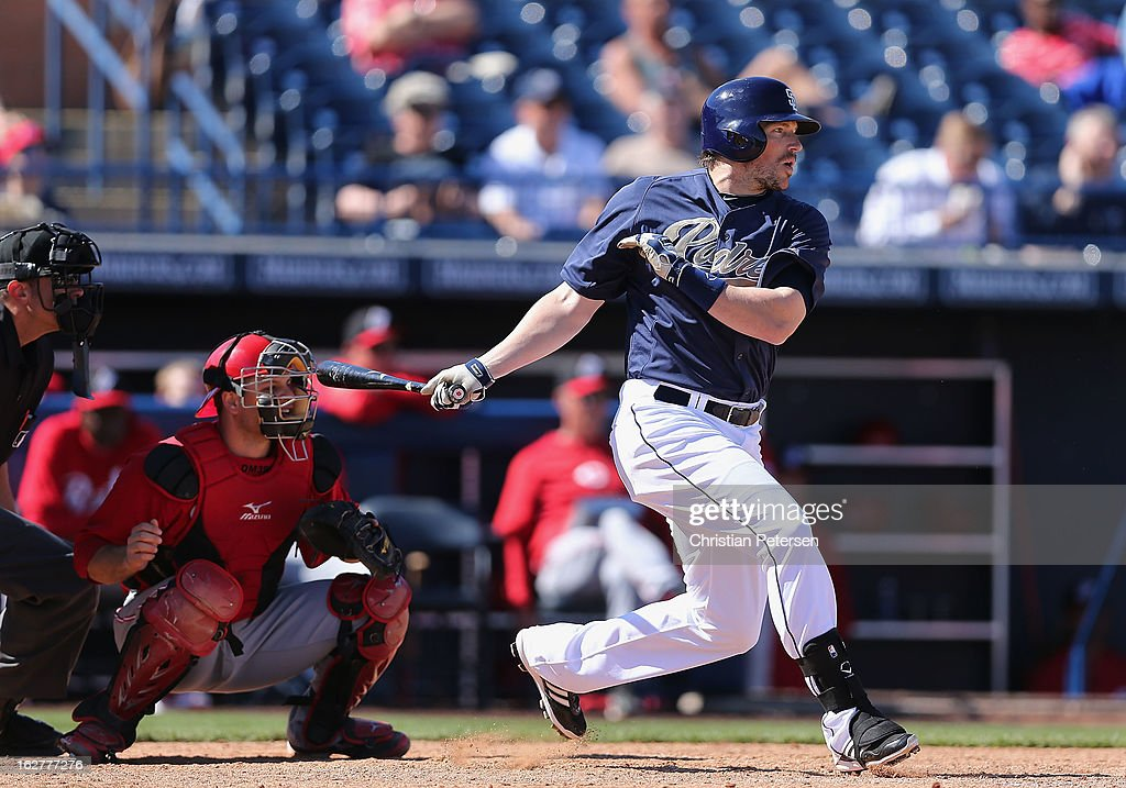 <a gi-track='captionPersonalityLinkClicked' href=/galleries/search?phrase=Travis+Buck&family=editorial&specificpeople=759114 ng-click='$event.stopPropagation()'>Travis Buck</a> #27 of the San Diego Padres hits a RBI single against the Cincinnati Reds during the fourth inning of the spring training game at Peoria Stadium on February 26, 2013 in Peoria, Arizona.