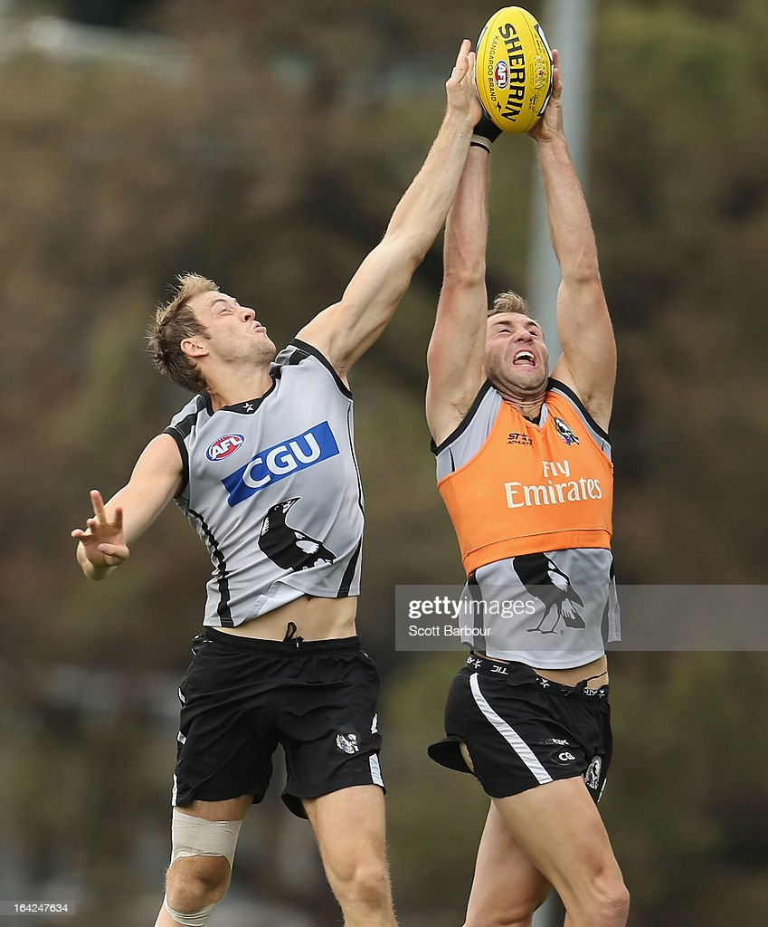 <a gi-track='captionPersonalityLinkClicked' href=/galleries/search?phrase=Travis+Cloke&family=editorial&specificpeople=228701 ng-click='$event.stopPropagation()'>Travis Cloke</a> and Ben Reid of the Magpies compete for the ball during a Collingwood Magpies AFL training session at Gosch's Paddock on March 22, 2013 in Melbourne, Australia.