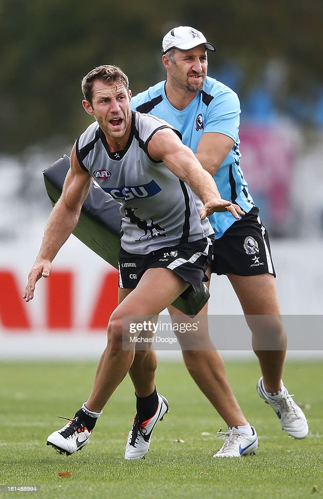 <a gi-track='captionPersonalityLinkClicked' href=/galleries/search?phrase=Travis+Cloke&family=editorial&specificpeople=228701 ng-click='$event.stopPropagation()'>Travis Cloke</a> calls for the ball in front of assistant coach <a gi-track='captionPersonalityLinkClicked' href=/galleries/search?phrase=Anthony+Rocca&family=editorial&specificpeople=208078 ng-click='$event.stopPropagation()'>Anthony Rocca</a> during a Collingwood Magpies AFL session at Westpac Centre on February 12, 2013 in Melbourne, Australia.