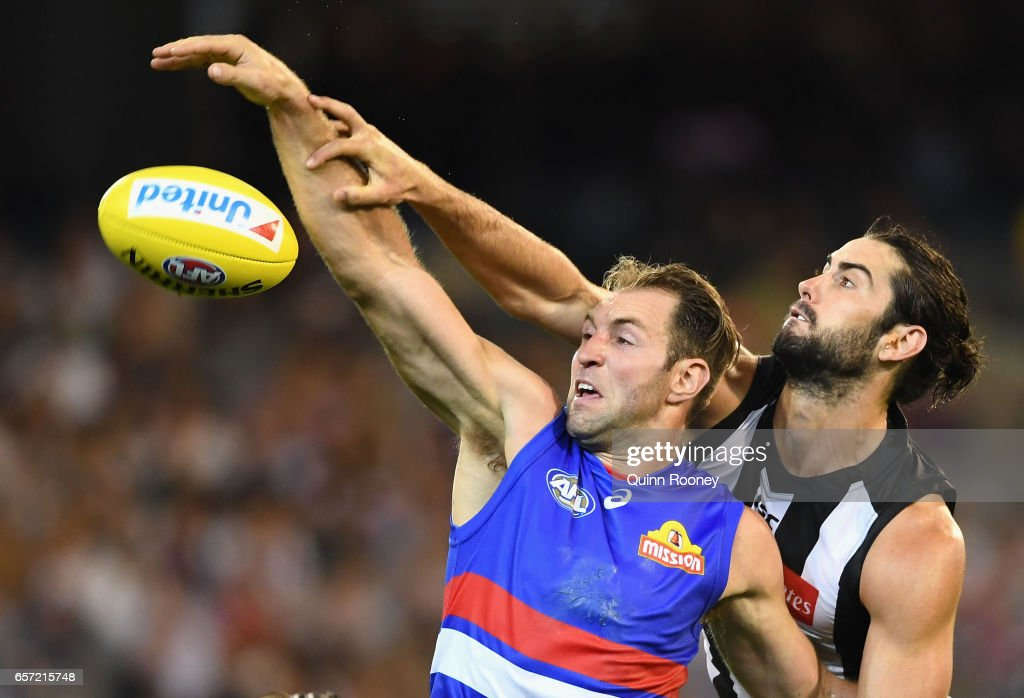 Travis Cloke of the Bulldogs competes in the ruck against Brodie Grundy of the Magpies during the round one AFL match between the Collingwood Magpies and the Western Bulldogs at Melbourne Cricket Ground on March 24, 2017 in Melbourne, Australia.