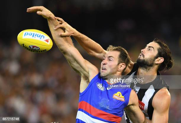 Travis Cloke of the Bulldogs competes in the ruck against Brodie Grundy of the Magpies during the round one AFL match between the Collingwood Magpies...