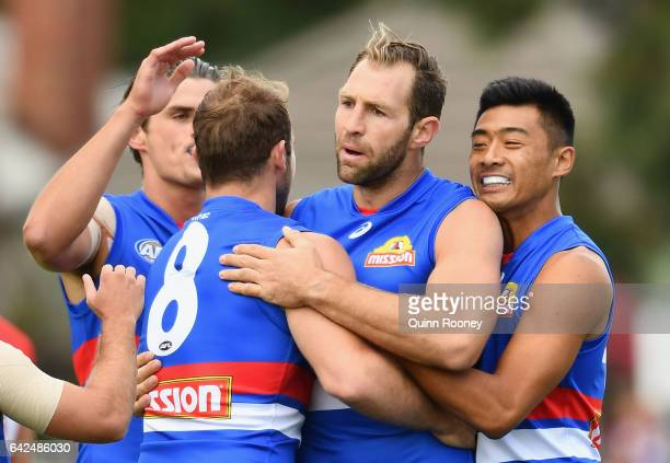 Travis Cloke of the Bulldogs is congratulated by team mates after kicking a goal during the 2017 JLT Community Series match between the Western...