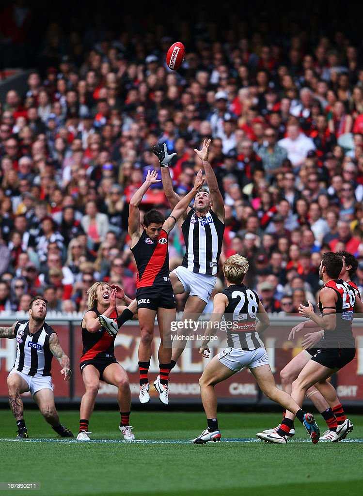Travis Cloke of the Magpies jumps to mark the ball during the round five AFL match between the Essendon Bombers and the Collingwood Magpies at Melbourne Cricket Ground on April 25, 2013 in Melbourne, Australia.