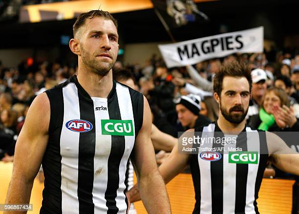 Travis Cloke of the Magpies leaves the field after the match during the 2016 AFL Round 23 match between the Hawthorn Hawks and the Collingwood...