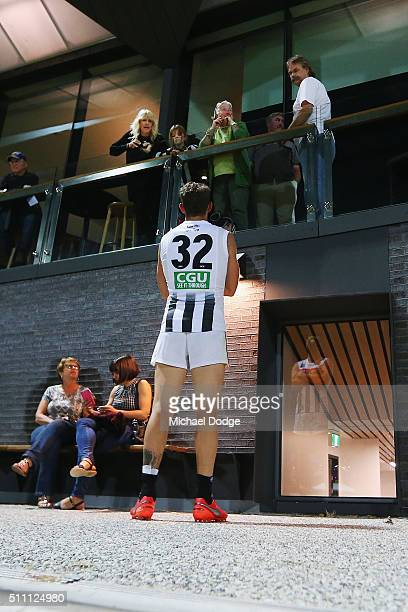 Travis Cloke of the Magpies listens to advice from his mum Julie Cloke and VFL legend David Cloke after the Collingwood Magpies AFL Intraclub match...