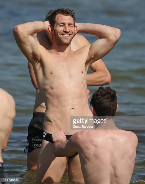 Travis Cloke of the Magpies looks on during a Collingwood Magpies AFL recovery session at the St Kilda Sea Baths on September 11 2012 in Melbourne...