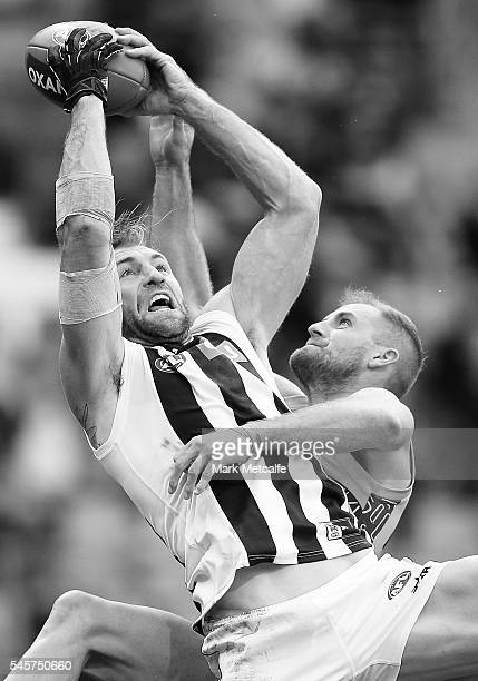 Travis Cloke of the Magpies marks the ball over Joel Patfull of the Giants during the round 16 AFL match between the Greater Western Sydney Giants...