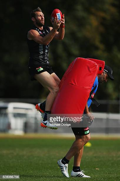 Travis Cloke of the Magpies relegated to the reserves for the past two weeks marks the ball during a Collingwood Magpies AFL training session on May...