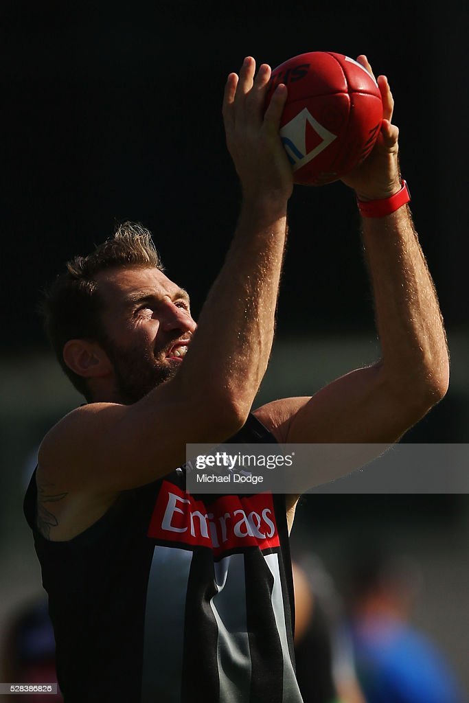 <a gi-track='captionPersonalityLinkClicked' href=/galleries/search?phrase=Travis+Cloke&family=editorial&specificpeople=228701 ng-click='$event.stopPropagation()'>Travis Cloke</a> of the Magpies, relegated to the reserves for the past two weeks, marks the ball during a Collingwood Magpies AFL training session on May 5, 2016 in Melbourne, Australia.