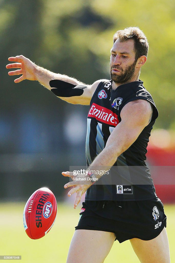<a gi-track='captionPersonalityLinkClicked' href=/galleries/search?phrase=Travis+Cloke&family=editorial&specificpeople=228701 ng-click='$event.stopPropagation()'>Travis Cloke</a> of the Magpies, relegated to the reserves for the past two weeks, kicks the ball with a strapped up arm during a Collingwood Magpies AFL training session on May 5, 2016 in Melbourne, Australia.