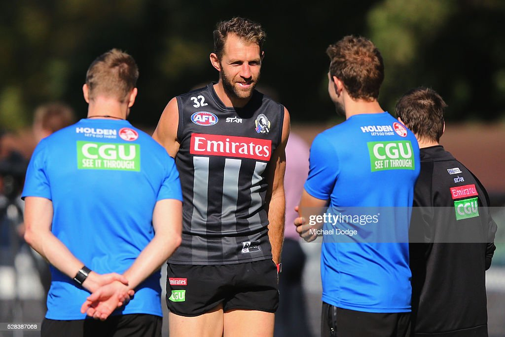 <a gi-track='captionPersonalityLinkClicked' href=/galleries/search?phrase=Travis+Cloke&family=editorial&specificpeople=228701 ng-click='$event.stopPropagation()'>Travis Cloke</a> of the Magpies, relegated to the reserves for the past two weeks, walks past Magpies head coach <a gi-track='captionPersonalityLinkClicked' href=/galleries/search?phrase=Nathan+Buckley&family=editorial&specificpeople=176545 ng-click='$event.stopPropagation()'>Nathan Buckley</a> (L) and off the ground after a Collingwood Magpies AFL training session on May 5, 2016 in Melbourne, Australia.