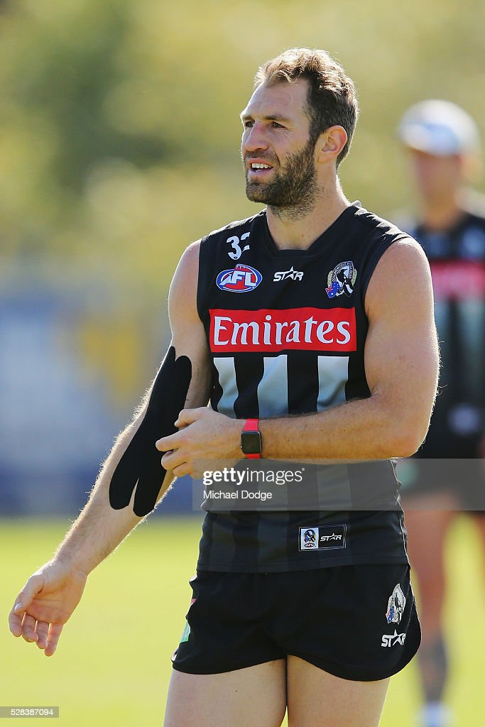 <a gi-track='captionPersonalityLinkClicked' href=/galleries/search?phrase=Travis+Cloke&family=editorial&specificpeople=228701 ng-click='$event.stopPropagation()'>Travis Cloke</a> of the Magpies, relegated to the reserves for the past two weeks, looks upfield with a strapped up arm during a Collingwood Magpies AFL training session on May 5, 2016 in Melbourne, Australia.