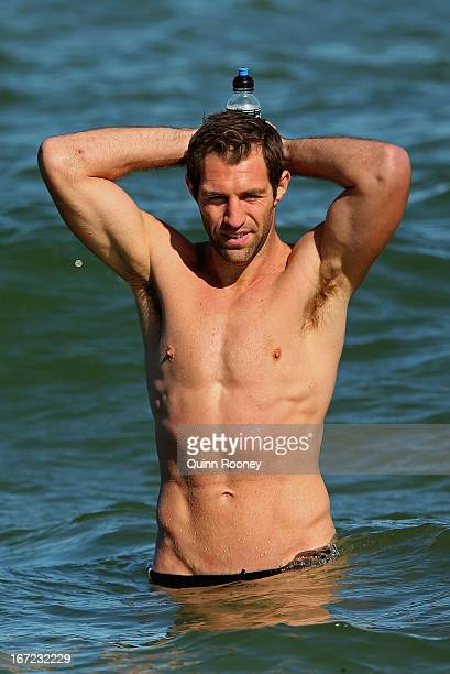 Travis Cloke of the Magpies wades in the water during a Collingwood Magpies AFL recovery session at the St Kilda Sea Baths on April 23 2013 in...