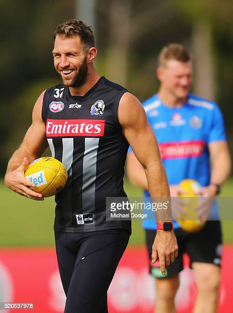 Travis Cloke reacts in front of Magpies head coach Nathan Buckley during a Collingwood Magpies AFL training session on April 12 2016 in Melbourne...