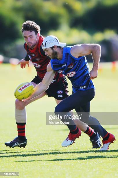 Travis Colyer of the Bombers gathers the ball from Heath Hocking of the Bombers during an Essendon Bombers AFL training session at True Value Centre...