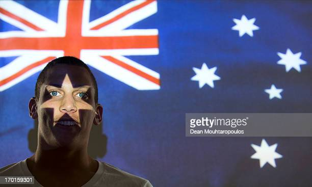 Travis Cooper of Australia and club team VVV Venlo poses in the light of the Australian Flag during a portrait session at De Koel Stadium on January...