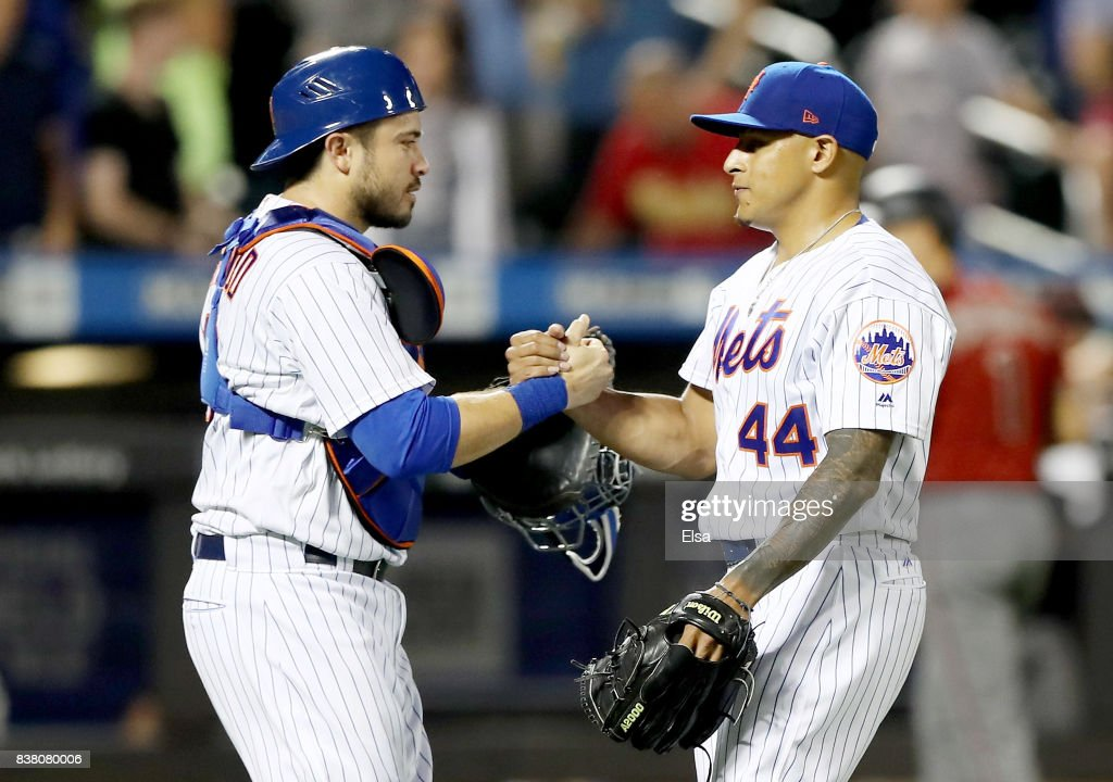 Travis d'Arnaud #18 and AJ Ramos #44 of the New York Mets celebrate the 4-2 win over the Arizona Diamondbacks on August 23, 2017 at Citi Field in the Flushing neighborhood of the Queens borough of New York City.