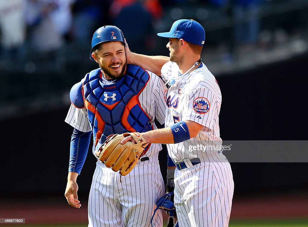 Travis d'Arnaud #7 and <a gi-track='captionPersonalityLinkClicked' href=/galleries/search?phrase=David+Wright+-+Baseball+Player&family=editorial&specificpeople=209172 ng-click='$event.stopPropagation()'>David Wright</a> #5 of the New York Mets celebrate the win over the Philadelphia Phillies on Opening Day on April 13, 2015 at Citi Field in the Flushing neighborhood of the Queens borough of New York City.