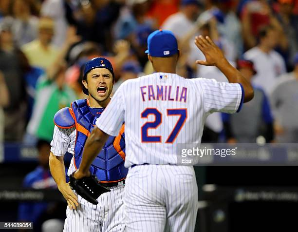 Travis d'Arnaud and Jeurys Familia of the New York Mets celebrate the 43 win over the Chicago Cubs at Citi Field on July 2 2016 in the Flushing...