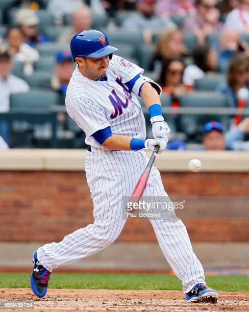Travis d'Arnaud of the New York Mets bats in an MLB baseball game against the Pittsburgh Pirates on June 4 2017 at CitiField in the Queens borough of...