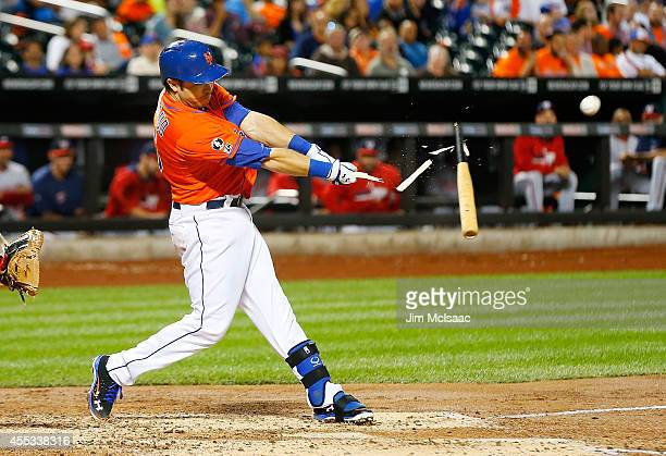 Travis d'Arnaud of the New York Mets breaks his bat as he flies out to end the third inning against the Washington Nationals at Citi Field on...