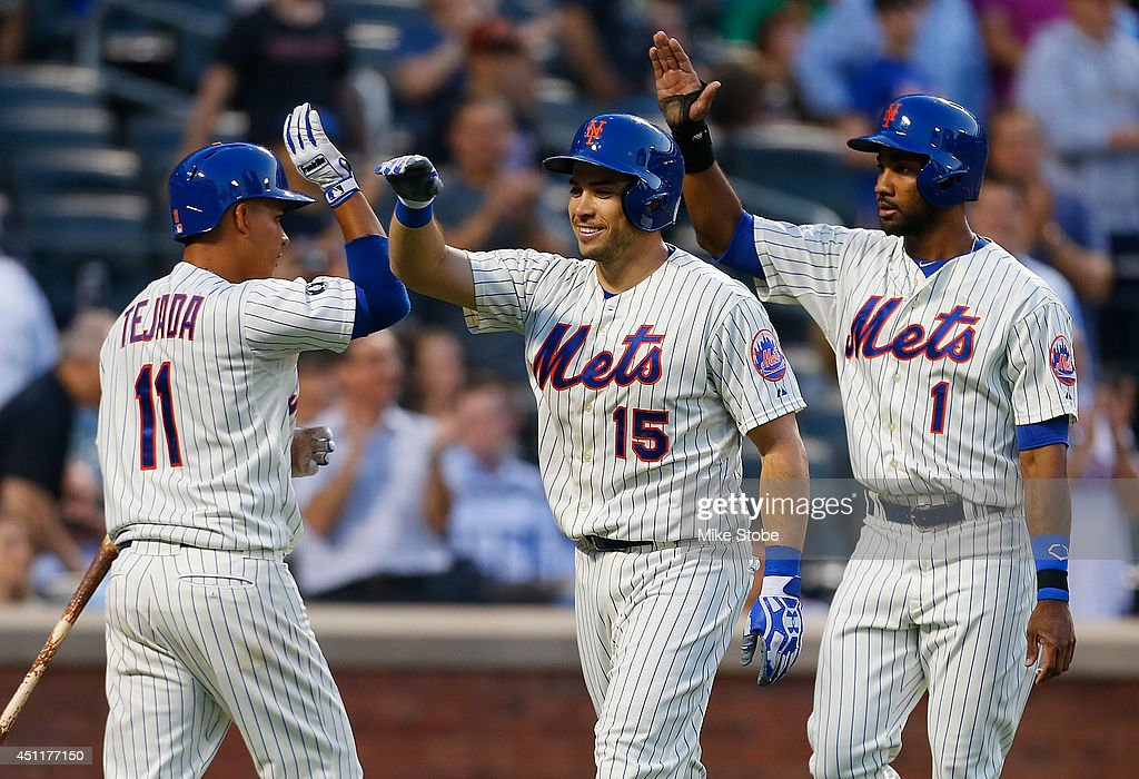 Travis d'Arnaud #15 of the New York Mets celebrates after hitting a three-run home run in the third inning against the Oakland Athletics at Citi Field on June 24, 2014 in the Flushing neighborhood of the Queens borough of New York City.