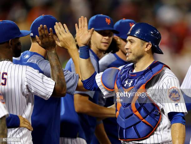 Travis d'Arnaud of the New York Mets celebrates the 54 win over the Texas Rangers during interleague play on August 8 2017 at Citi Field in the...