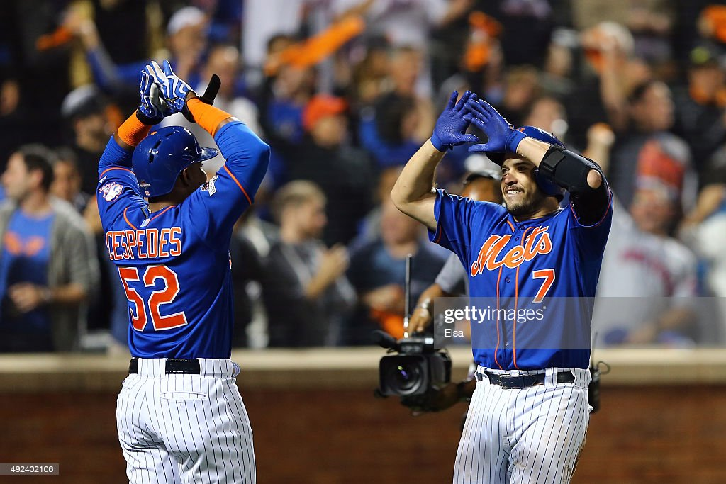 Travis d'Arnaud #7 of the New York Mets celebrates with <a gi-track='captionPersonalityLinkClicked' href=/galleries/search?phrase=Yoenis+Cespedes&family=editorial&specificpeople=8892047 ng-click='$event.stopPropagation()'>Yoenis Cespedes</a> #52 after hitting a two run home run in the third inning against Brett Anderson #35 of the Los Angeles Dodgers during game three of the National League Division Series at Citi Field on October 12, 2015 in New York City.