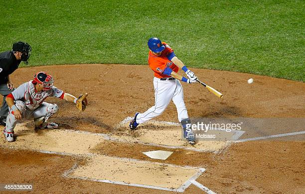Travis d'Arnaud of the New York Mets connects on a first inning two run double against the Washington Nationals at Citi Field on September 12 2014 in...
