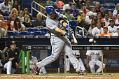 Travis d'Arnaud of the New York Mets hit a single during the 4th inning of the game between the Miami Marlins and the New York Mets at Marlins Park...