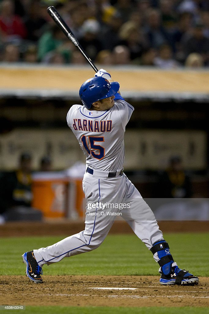 Travis d'Arnaud #15 of the New York Mets hits a home run against the Oakland Athletics during the fourth inning of an interleague game at O.co Coliseum on August 19, 2014 in Oakland, California.