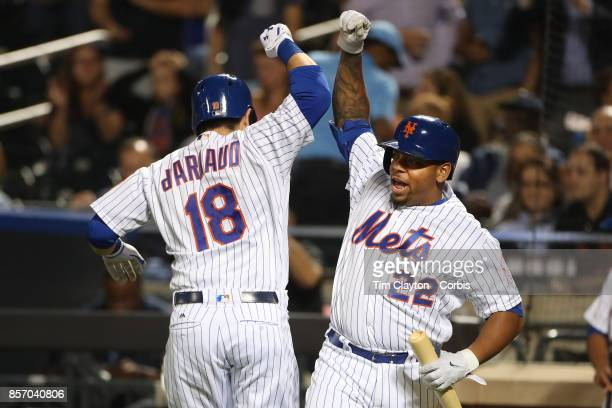 Travis d'Arnaud of the New York Mets is congratulated by Dominic Smith of the New York Mets after hitting a home run during the Washington Nationals...