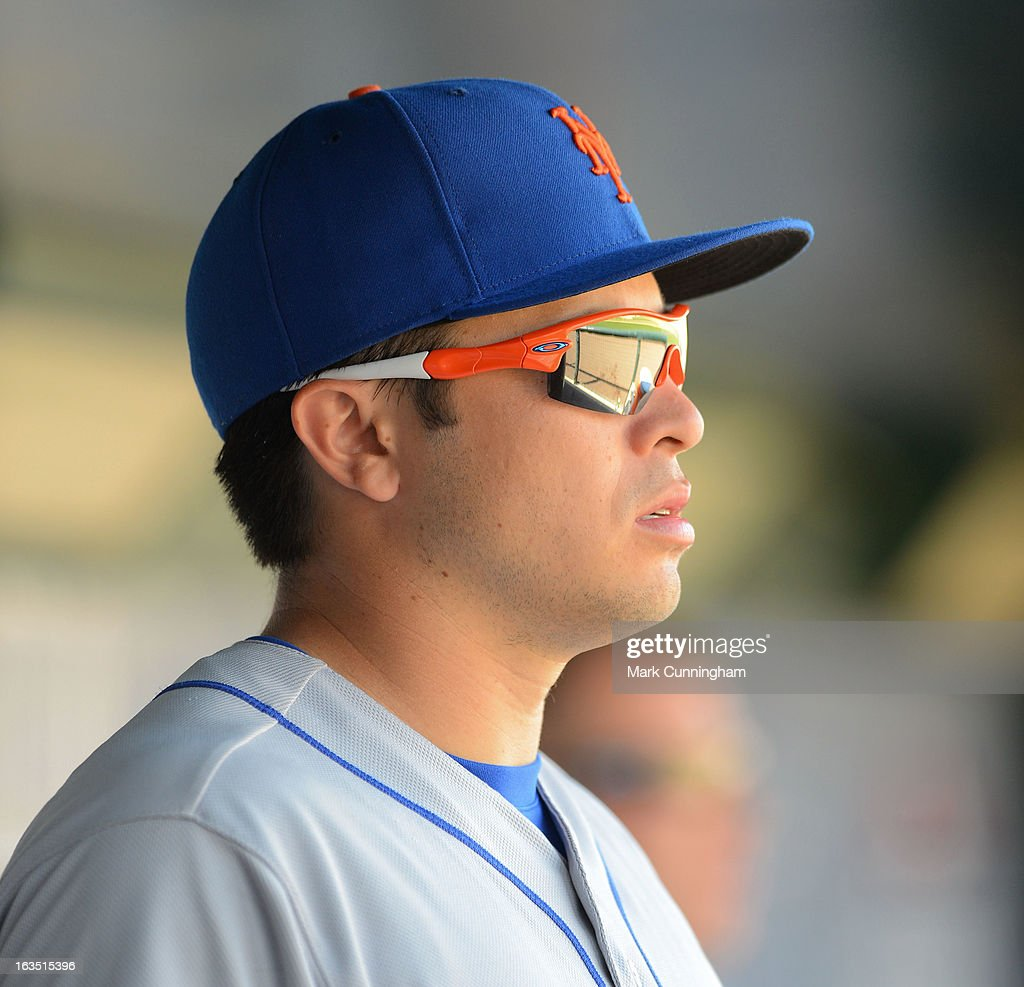 Travis d'Arnaud #15 of the New York Mets looks on from the dugout during the spring training game against the Detroit Tigers at Joker Marchant Stadium on March 8, 2013 in Lakeland, Florida. The Tigers defeated the Mets 3-2.