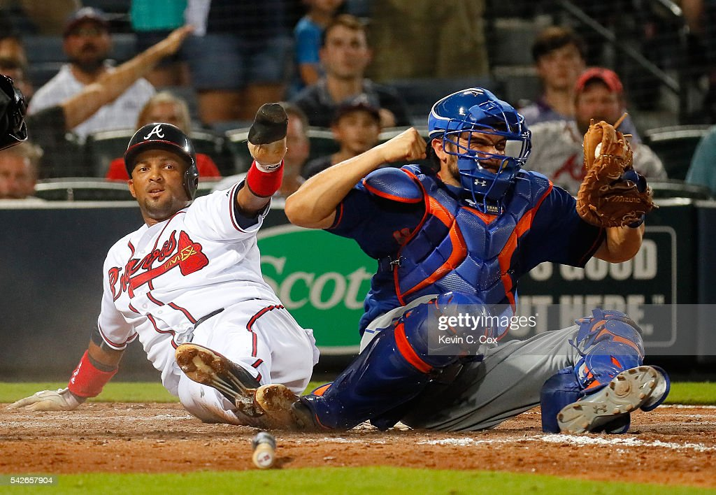 Travis d'Arnaud #7 of the New York Mets reacts as homeplate umpire Jordan Baker #71 calls out <a gi-track='captionPersonalityLinkClicked' href=/galleries/search?phrase=Emilio+Bonifacio&family=editorial&specificpeople=4193706 ng-click='$event.stopPropagation()'>Emilio Bonifacio</a> #64 of the Atlanta Braves to end the seventh inning at Turner Field on June 23, 2016 in Atlanta, Georgia.
