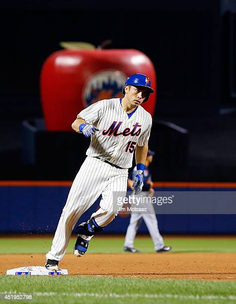 Travis d'Arnaud of the New York Mets runs the bases after his seventh inning two run home run against the Atlanta Braves at Citi Field on July 9 2014...