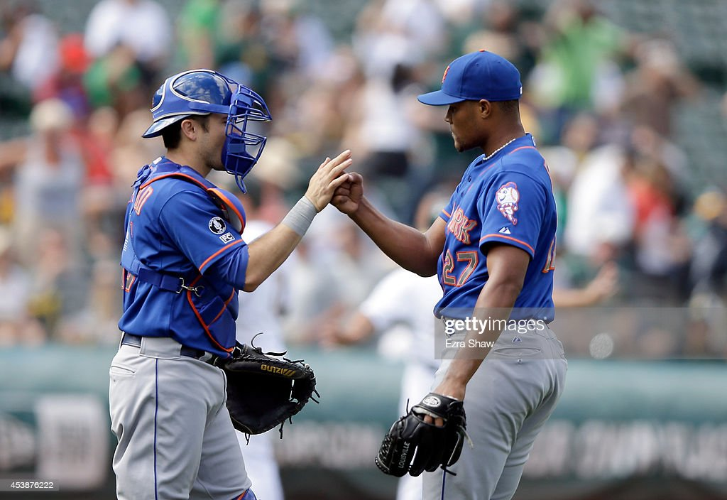 Travis d'Arnaud #15 of the New York Mets shakes hands with <a gi-track='captionPersonalityLinkClicked' href=/galleries/search?phrase=Jeurys+Familia&family=editorial&specificpeople=8992911 ng-click='$event.stopPropagation()'>Jeurys Familia</a> #27 after they beat the against the Oakland Athletics at O.co Coliseum on August 20, 2014 in Oakland, California.