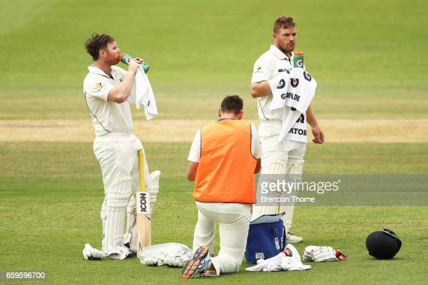 Travis Dean and Aaron Finch of the Bushrangers take a drinks break during the Sheffield Shield final between Victoria and South Australia on March 29...