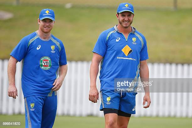Travis Dean and Daniel Worrall talk during an Australia A training session at Allan Border Field on September 6 2016 in Brisbane Australia
