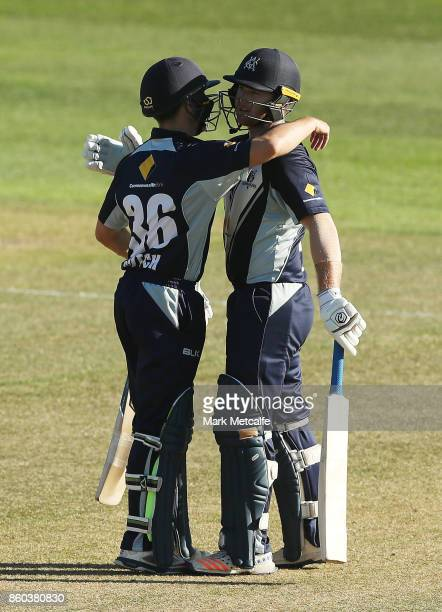 Travis Dean of the Bushrangers celebrates with Seb Gotch of the Bushrangers after scoring a century during the JLT One Day Cup match between Victoria...