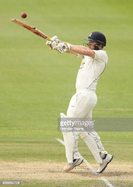 Travis Dean of the Bushrangers hits for six during the Sheffield Shield final between Victoria and South Australia on March 29 2017 in Alice Springs...