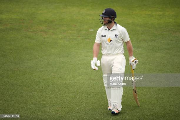 Travis Dean of the Bushrangers looks dejected after being dimissed by Jason Behrendorff of the Warriors during the Sheffield Shield match between...