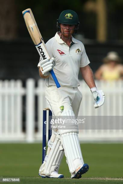 Travis Dean of the CA XI raises his bat to celebrate his century during the Two Day tour match between the Cricket Australia CA XI and England at...
