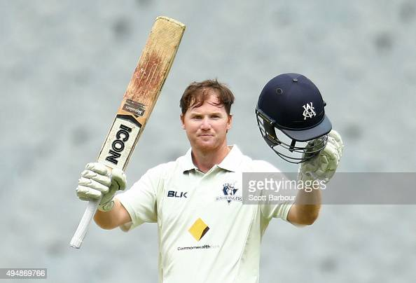 Travis Dean of Victoria celebrates as he reaches his century during day three of the Sheffield Shield match between Victoria and Queensland at...