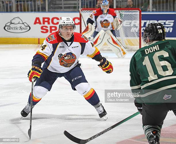 Travis Dermott of the Erie Otters defends against the London Knights during Game Three of the OHL Western Conference SemiFinal at Budweiser Gardens...